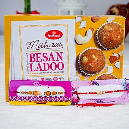 Two Rakhi With Indian Sweet Besan Ladoo
