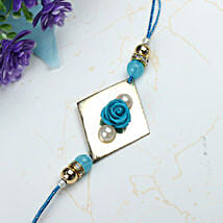 Blue Rose with Pearl Rakhi BEL: