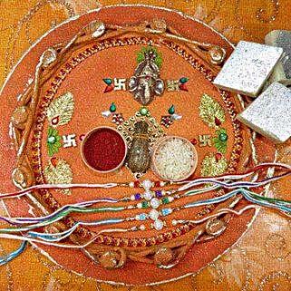 Colorful Rakhi Set Of Five Thali With Kaju Katli: Rakhi to Canada