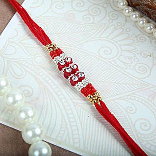White Crystals N Red Thread Rakhi: Rakhi to Canada