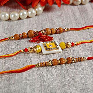 Yellow Stone Sandalwood Rakhi Set: Send Rakhi to Finland