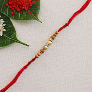Golden Designer Red Rakhi Thread: Rakhi Delivery in Greece