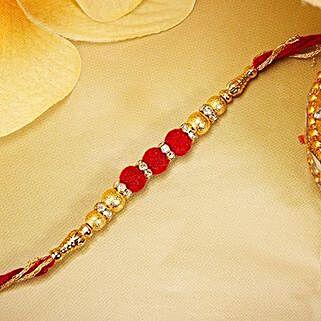 Gold And Red Velvet Beads Rakhi: Send Rakhi to Japan