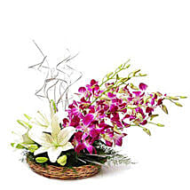 Lilies And Orchids Basket Arrangement: Mixed flowers