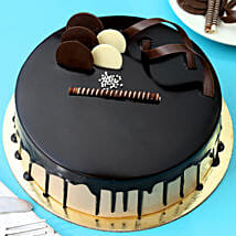 Chocolate Cream Cake: Send Flowers & Sweets for Holi