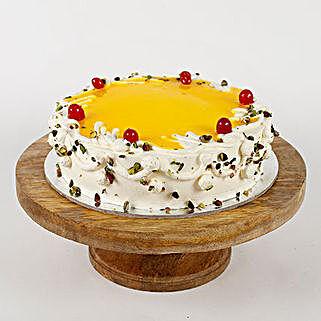 Cream Pista Cake: Send Pineapple Cakes to Delhi