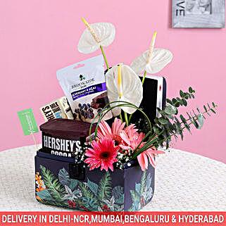 Exotic Flowers & Delicious Hershey's Delight Box: Rakhi Gift Baskets