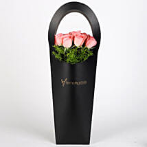 Pink Roses in Stylish Black Sleeve: Womens Day Gifts for Wife