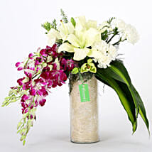 Orchids & Carnations Vase Arrangement: Send Anniversary Flowers to Noida