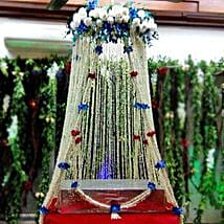 White Sparkling Flower Tower Decoration: Temple Flower Decorations