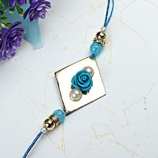 Blue Rose with Pearl Rakhi OMA: Send Rakhi to Oman