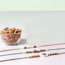 Combo Of Almonds And 3 Glorious Rakhis: Rakhi with Dryfruits to Oman
