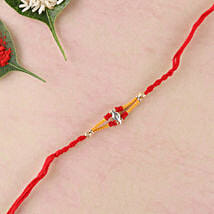 Hand Crafted Red Elegant Rakhi Thread: Rakhi Delivery in Portugal