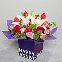 Tulips Roses and Carnations in Glass Vase: