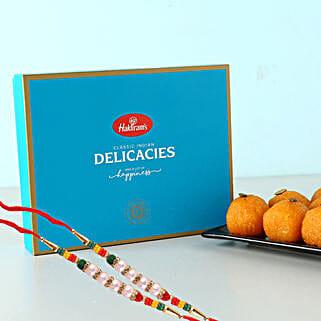 2 Pearl Rakhis And Motichoor Laddus Tasty Combo: Rakhi and Sweets to UK