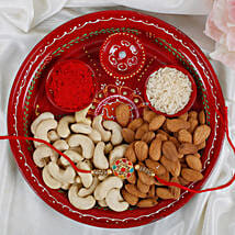 Premium Navrang Rakhi with Puja thali Dry fruits Rakhi Hamper: Rakhi to Leeds