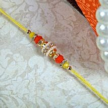 Sparkling yellow Thread: Rakhi to Edinburgh