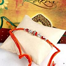 Glittering Maroon Rakhi Thread: Rakhi to San Francisco