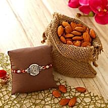 Om Dial Rakhi with Almonds: Rakhi with Dryfruits to USA