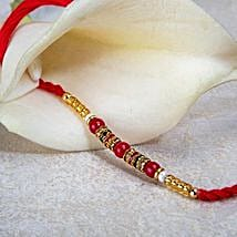 Red And Golden Bead Rakhi: Rakhi Delivery in Zambia